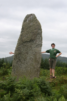 Jessica waving at standing stone