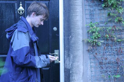 Neil locking the door